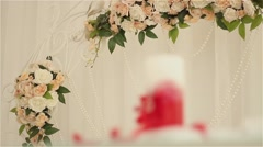 Decorated place with one red and white candle Stock Footage