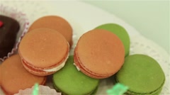 Tasty colorful macaroon and chocolate on white table Stock Footage