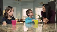 Mom Feeding Kids Stock Footage