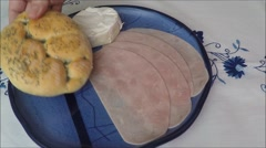 Ham slices isolated on a blue plate Stock Footage