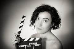 Seductive actress with clapperboard, vintage black and white closeup Stock Photos