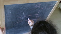 Top view of mother and kid learning to write on a board Stock Footage