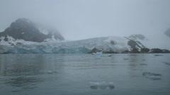 Driving through icy ocean Near Glacier - stock footage