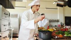 Female Chef working in kitchen Stock Footage