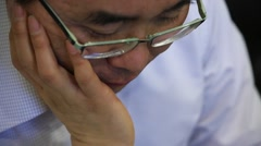 Businessman with work stress taking off his glasses and thinking in the restaura Stock Footage