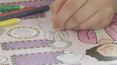 Girl colouring in book Stock Footage