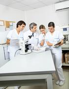 Scientists Working Together In Medical Lab Stock Photos