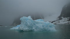 Blue Ice Berg Floating in Fog Stock Footage