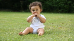 baby sat outdoors - stock footage
