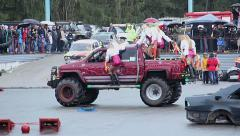 Girls cheerleaders mini skirts jump off Bigfoot car, stunt show Stock Footage