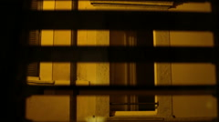 Closeup view through Window shutters on a lane. Italy. - stock footage