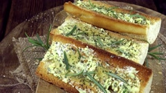 Homemade Garlic Baguette (loopable) - stock footage