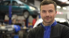 Portrait of smiling mechanic in auto repair shop Stock Footage