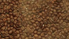 Close-Up Steamy Coffee Beans In Slow Motion Stock Footage