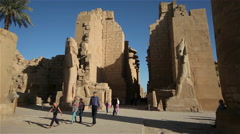TOURSITS AT COLOSSUS RAMSES II, TEMPLE AMUN, KARNAK, EGYPT Stock Footage