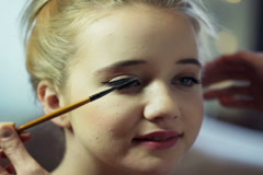 Young, pretty girl getting eyelashes makeup at beauty salon NTSC Stock Footage