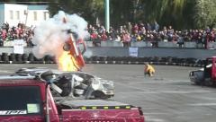 Stunt car flips over, explodes. Thrilled audience. Part2of2 Stock Footage