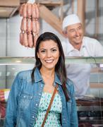 Beautiful Woman Smiling At Butchery - stock photo