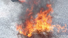 Closeup gasoline puddle on fire, burning liquid, accident, crash Stock Footage