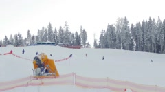 Skiers ride on the piste, the view from the lift Stock Footage