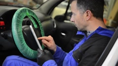 Mechanic doing technical inspection on vehicle Stock Footage