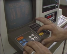 1980s industrial computer terminal + video display, input data - shoulder shot Stock Footage