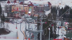 Skiers ascend on the ski lift up to the mountain Stock Footage