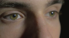 4k UHD - Close-up of a young man eyes opening and blinking - stock footage