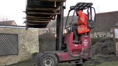 Forklift driver turning large, heavy load around. Stock Footage