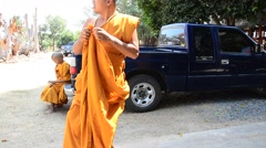 Monk wearing robe or clothing of a Buddhist monks Stock Footage
