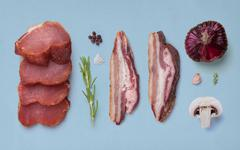 Composition of vegetables and meat isolated on a blue background Stock Photos