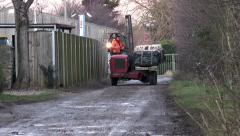 Forklift driver carrying large, heavy load along lane. Stock Footage