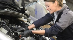 Technician woman working in auto repair workshop - stock footage