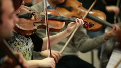 Many violins. Bowed string instrument in the orchestra. - stock footage