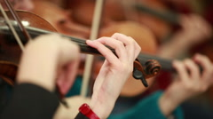 Woman playing the violin. Bowed string instrument in the orchestra. - stock footage