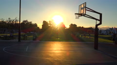 Teams play a pickup game at a local park at sunset. Stock Footage