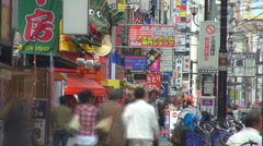 Timelapse people commute transit crowded shopping street Osaka downtown day icon Stock Footage
