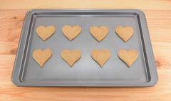 Eight plain heart-shaped cookies Stock Photos