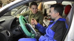 Mechanic doing technical inspection on individual car - stock footage