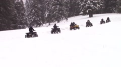Quads on snow trail Stock Footage