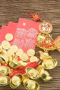 Chinese new year festival decorations, ang pow or red packet and gold ingots. Stock Photos