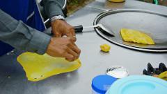 CHIANG MAI, THAILAND - CIRCA DEC 2013: Local street food vendor preparing ome Stock Footage