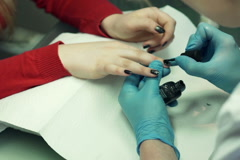 Young woman doing manicure at beauty salon NTSC - stock footage