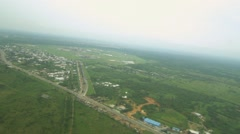 Ariel shot of riverine swamps and buildings  from helicopter Stock Footage