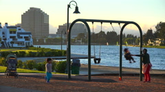 Families exercise on a playground in a new suburban neighborhood near Palo Alto, Stock Footage