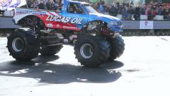 Bigfoot crashing another car, monster truck, extreme stunt show - stock footage