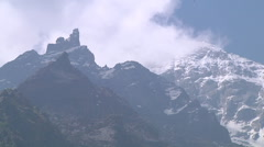 Snowy mountains and clouds at Gangotri in Uttarakhand, India Stock Footage