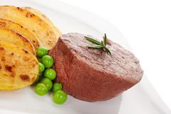Stock Photo of Mignon steak with fresh vegetable.