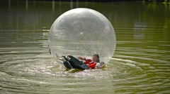 CHIANG MAI, THAILAND - CIRCA DEC 2013: Tourists Zorbing at Chiang Mai Zoo in  Stock Footage