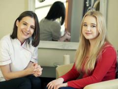 Happy female cosmetician with her client at beauty salon NTSC Stock Footage